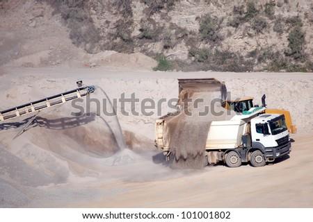 processing plant stones and excavator loading dumper truck...