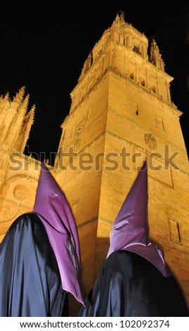 Procession during the Semana Santa in Salamanca, Spain.This is the Holy week before Easter.At the background the cathedral of Salamanca. The old city of Salamanca is an Unesco World Heritage site.