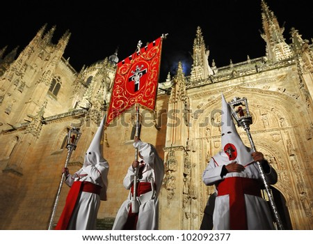 Procession during the Semana Santa in Salamanca, Spain.(this is the Holy week before Easter).At the background the cathedral of Salamanca. The old city of Salamanca is an Unesco World Heritage site - stock photo