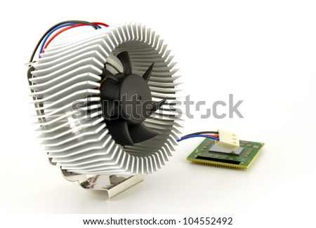 Processor and fan with radiator over white. Shallow DOF.