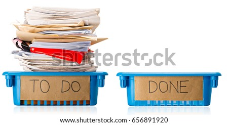 Procrastination - A full To Do tray and an empty Done tray - Overwhelmed - Isolated on white background