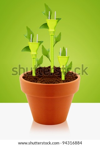producing electricity from green ways, three green electricity plug with green leaves into clay garden pot.