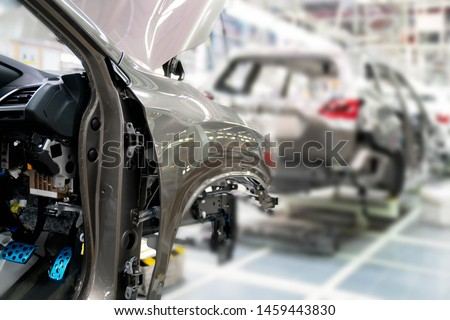 Production line for manufacturing of the car body in the car factory. Car factory. Car parts. Body factory. New body factory. Vehicle body on line.