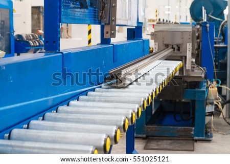 Production line for manufacturing of the engines factory. Factory. Engine factory. New engine factory. Engines on line. Steel beam on the line