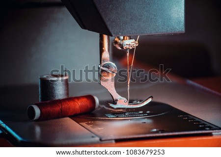 Production line sewing machine. Needle and footstep detail #1083679253
