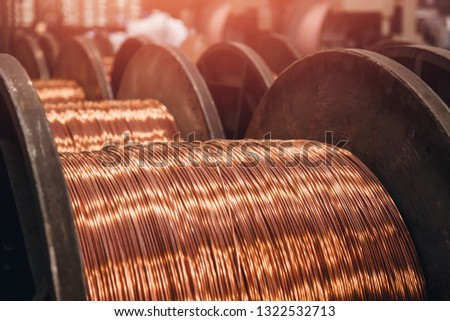 Production of copper wire, bronze cable in reels at factory. ストックフォト ©