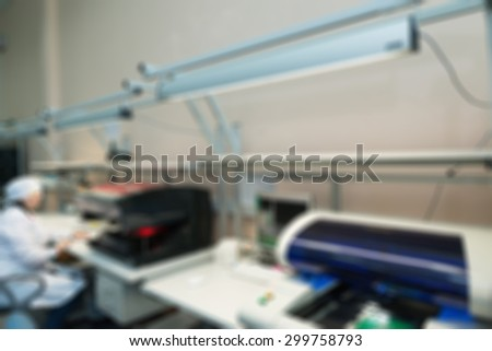 Production of electronic components  at high-tech factory blur background with bokeh