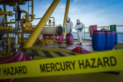 production operator operate mercury hazard waste disposal at oil and gas process, oil and rig plant, offshore oil and gas industry, offshore oil and rig in the sea, production process.