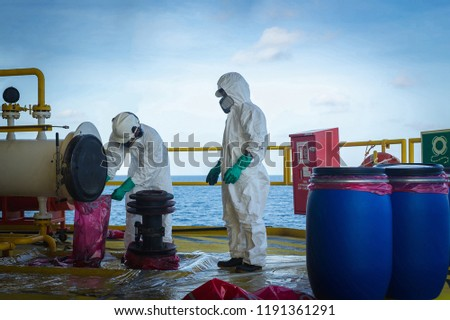 production operator operate mercury hazard waste disposal at oil and gas process, oil and rig plant, offshore oil and gas industry, offshore oil and rig in the sea.