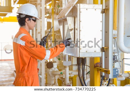 Production operator operate touch screen panel view for operating control valve which command by programmable logic controller, Oil and gas operation activity for control gas process.