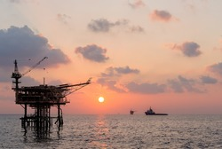 production platform rig in oil field when sunset