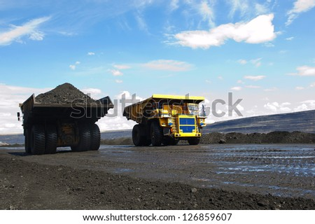 Production useful minerals The two dump trucks