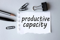 productive capacity, text on white paper on gray background