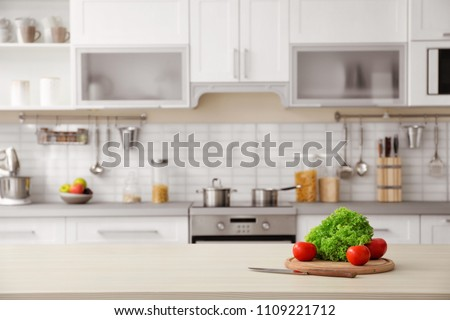 Products and blurred view of kitchen interior on background