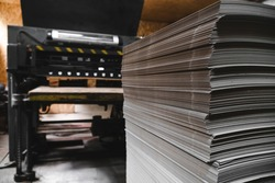 Products and corrugated cardboard. Factory for the manufacture and processing of paper. Sheets, stacks. Selective focus. Capacities and packaging. Large format printing. Industrial Printer