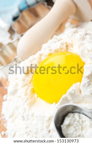 products for baking - flour and egg, close-up, vertical