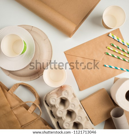 products made from recycled paper: disposable tableware, package, box, cardboard, egg packaging, envelope, toilet paper, Kraft paper. concept: environmental protection, nature conservation, recycle.