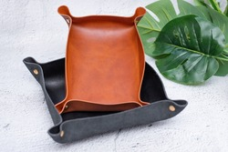Products made of genuine leather. Tray for small items made of handmade leather. Products for sale made of genuine leather