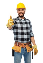 profession, construction and building - happy smiling male worker or builder in helmet and goggles showing thumbs up over white background