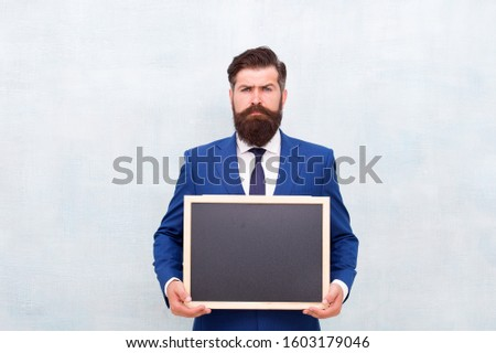 Professional academy. Businessman hold school blackboard. Business education. Study business. Education and study. Education course. Online education. Learn anytime anywhere, copy space.