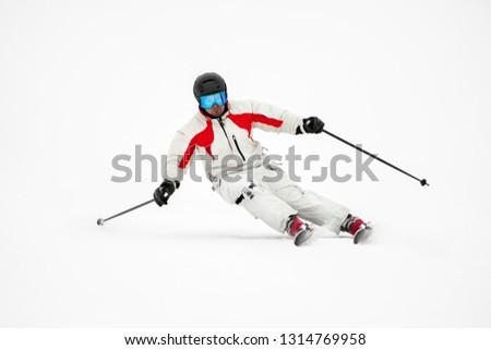 Professional alpine slalom skier skiing on prepared piste on fresh snow in mountains , action camera on leg