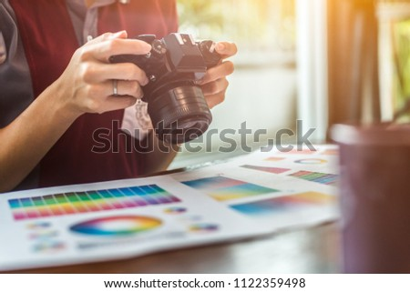Professional Asian women working with colour samples for selection. Architectural drawing with work tools and accessories. #1122359498