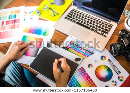 Professional Asian women working with colour samples for selection. Architectural drawing with work tools and access #1157186488