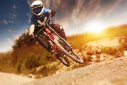 Professional athlete high jump on a mountain bike.