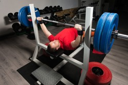Professional Athlete Is Lying and Is Holding a Very Heavy Barbell