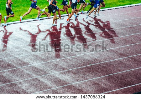 Professional athlete legs during the track and field race. Concept photo for olympic competition in tokyo 2020