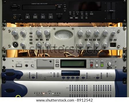 Professional audio equipment components on rack