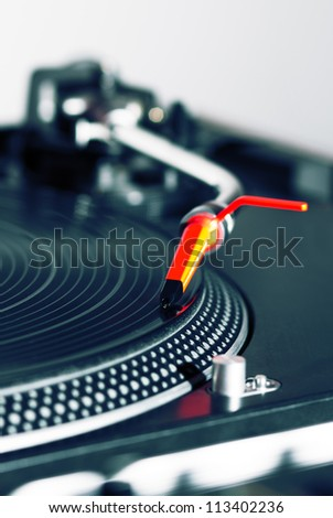 Professional audio equipment for a DJ - turntable playing record with music