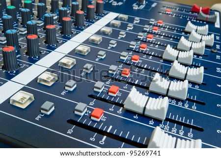professional audio mixer with shallow depth of field