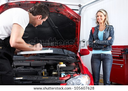 Professional auto mechanic and  a client woman.