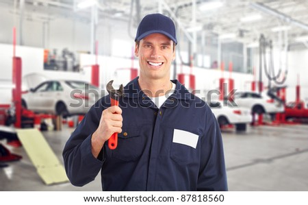 Professional auto mechanic in auto repair shop. Garage.