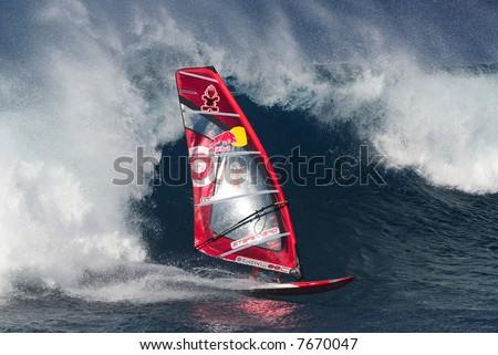 Professional big wave windsurfing in Maui Hawaii - stock photo
