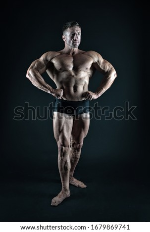 Professional bodybuilder. Bodybuilder black background. Fit bodybuilder show muscular body. Strong bodybuilder with six pack abs. Muscle man. Strength training. Bodybuilding and fitness.
