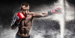Professional boxer breaks the barrier with a glove. Dust and debris spilled over. 3d rendering. Sports concept. Mixed media