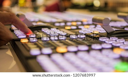Professional broadcast video mixer in studio in action.