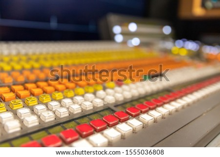 Professional broadcast video switcher used during live television productions, shallow depth of field.