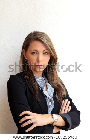 Professional Brunette Business Woman Standing While Serious and Having Arms Crossed