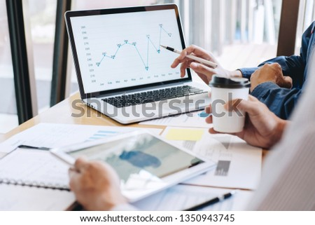 Professional Business casual partner discussing ideas plan and presentation project at meeting working and analysis at workspace office, financial and investment concept. #1350943745