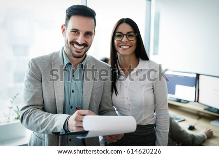 Professional business colleagues working in modern office #614620226