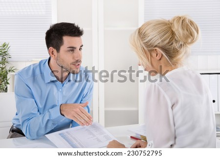 Professional business meeting: consultant explain his female customer the risc and possibilities of provision for one\'s old age.