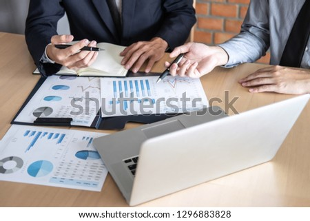 Professional Business partner discussing ideas planning and presentation project at meeting working and analysis at workspace, financial and investment concept, collaborative teamwork analyze data. #1296883828