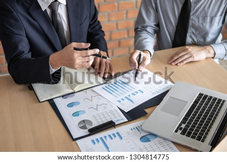 Professional Business partner discussing ideas planning and presentation project at meeting working and analysis at workspace, financial and investment concept, collaborative teamwork analyze data. #1304814775