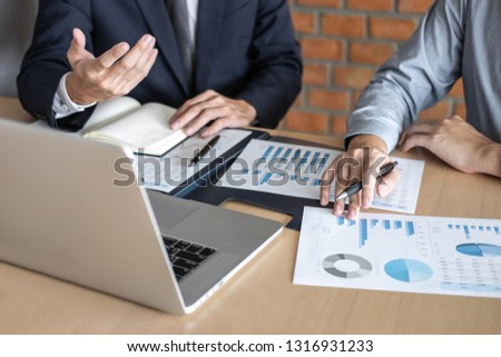 Professional Business partner discussing ideas planning and presentation project at meeting working and analysis at workspace, financial and investment concept, collaborative teamwork analyze data. #1316931233