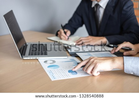 Professional Business partner discussing ideas planning and presentation project at meeting working and analysis at workspace, financial and investment concept, collaborative teamwork analyze data. #1328540888