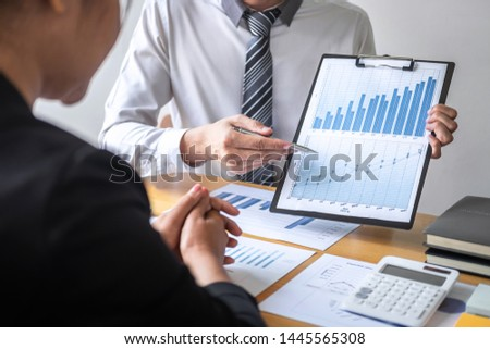 Professional Business partner discussing ideas planning and presentation project at meeting working and analysis at workspace, financial and investment concept, collaborative teamwork analyze data. #1445565308