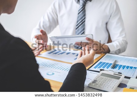 Professional Business partner discussing ideas planning and presentation project at meeting working and analysis at workspace, financial and investment concept, collaborative teamwork analyze data. #1453832498